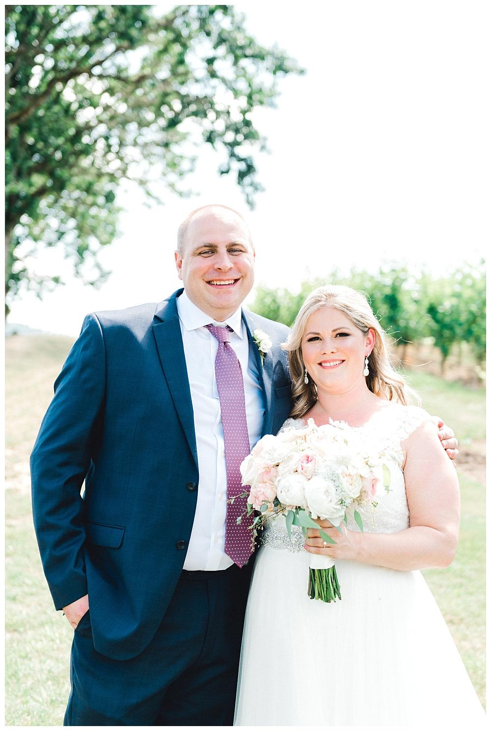 bride and groom portrait in front of vineyard