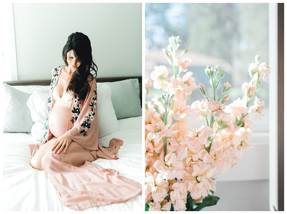 pregnant mother in bedroom with pink kimono and floral arrangement on nightstand
