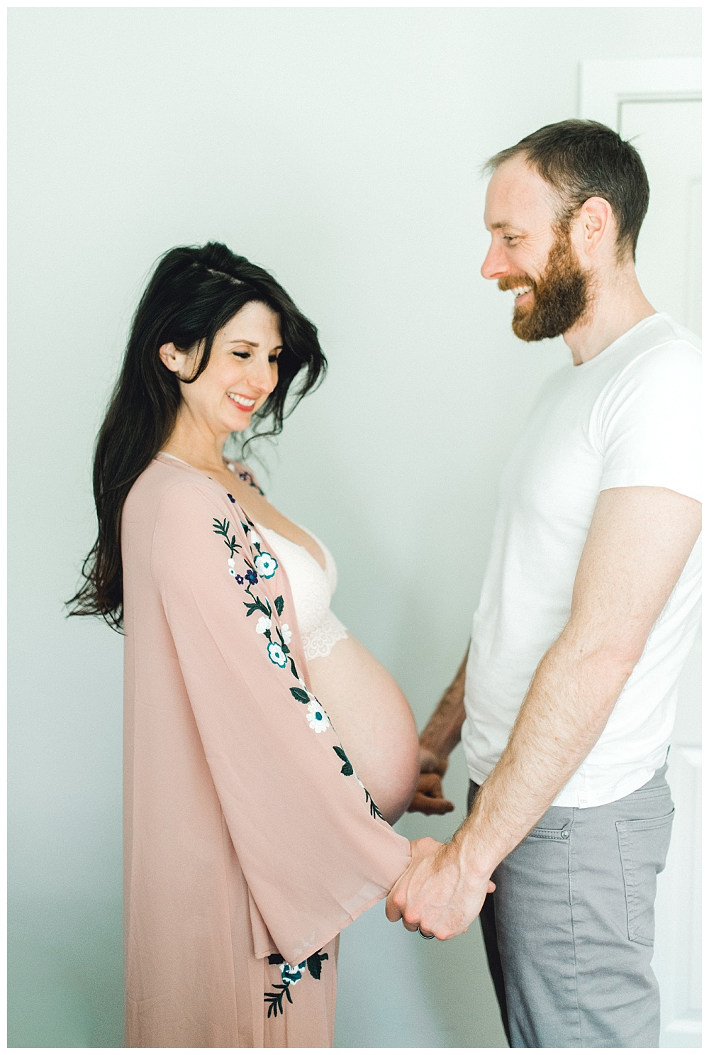 in-home maternity boudoir session, husband holding hands with pregnant wife, Beaverton, OR
