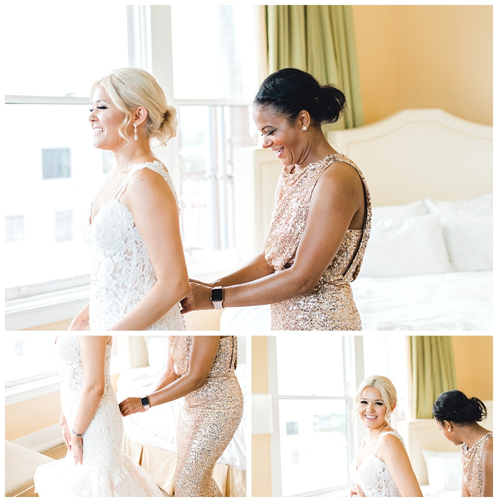 maid of honor helping bride put dress on, laughter and emotions in getting ready room at the hotel deluxe in portland oregon