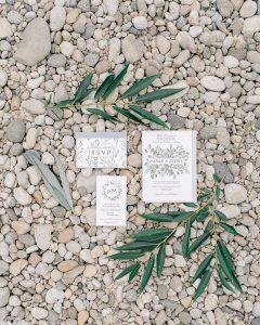 beautiful modern invitation suite on river rocks
