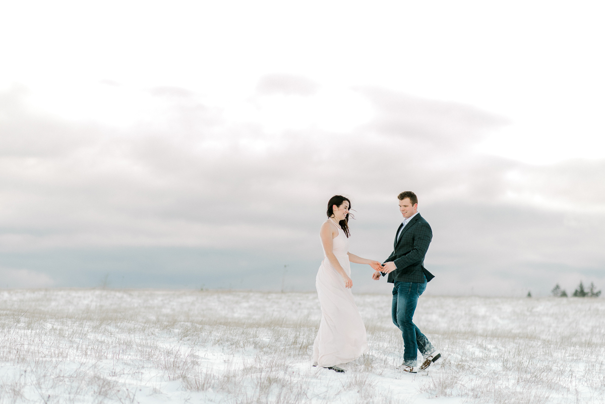 Portland Oregon snowy engagement session in open field.