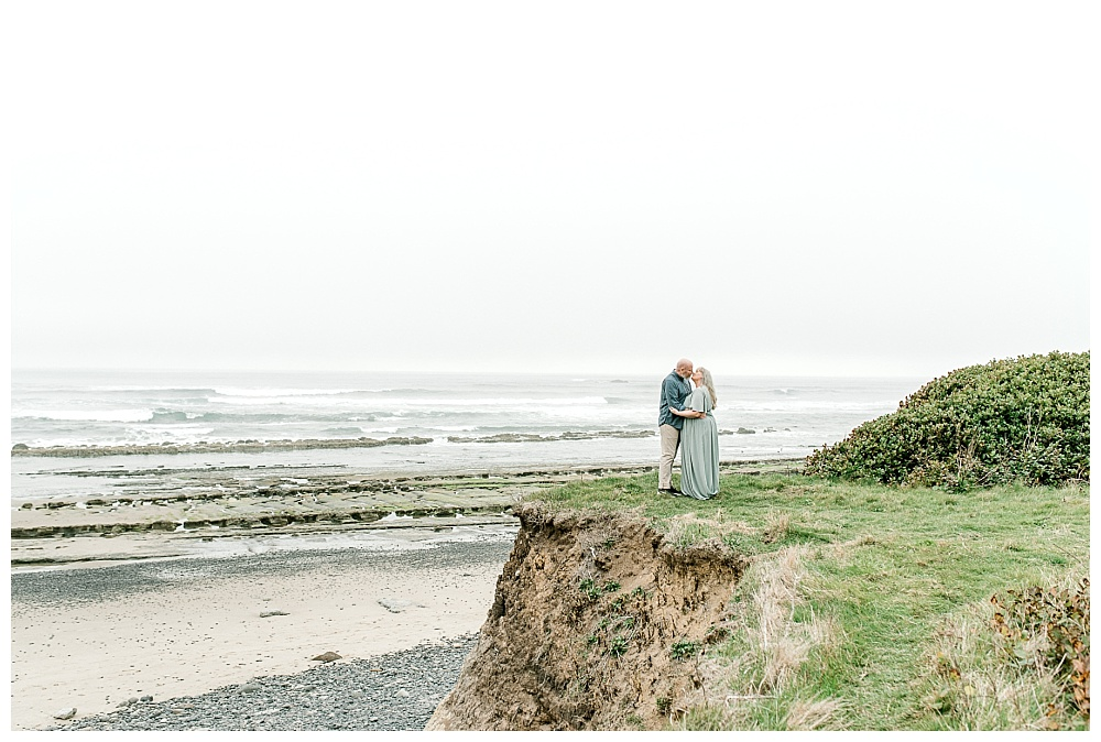 couples photo of oregon coast beach with lighthouse in background