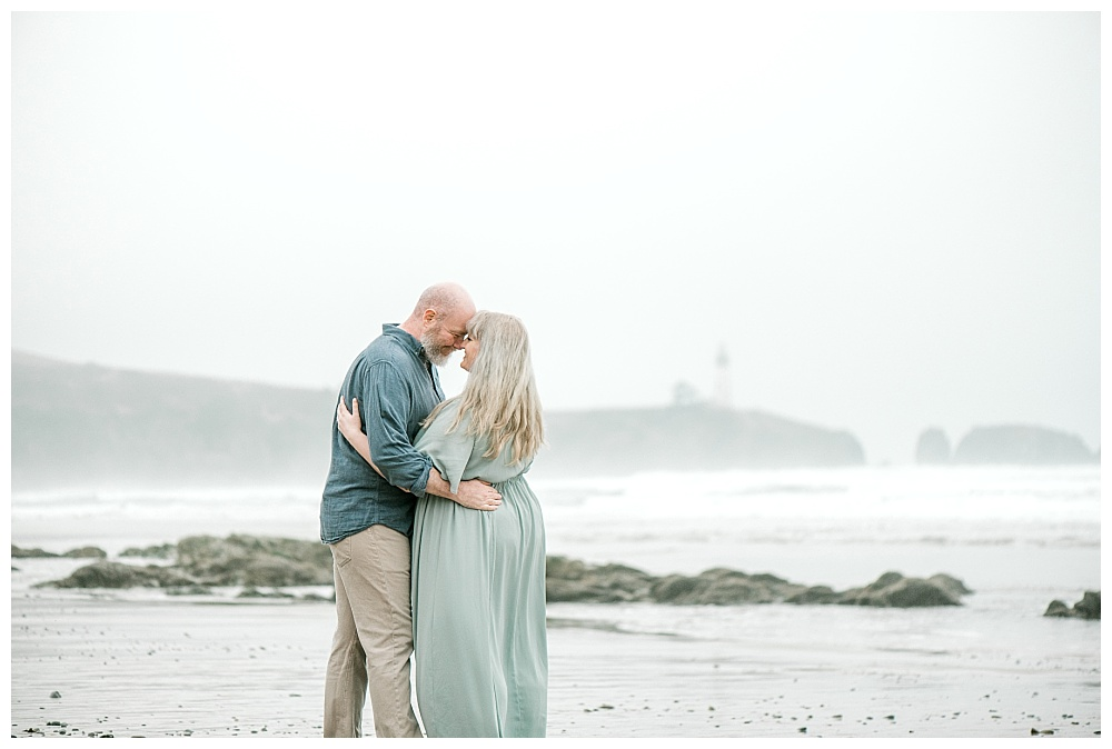 portrait photos of misty oregon coast engagement session at low tide. lauryn kay photography