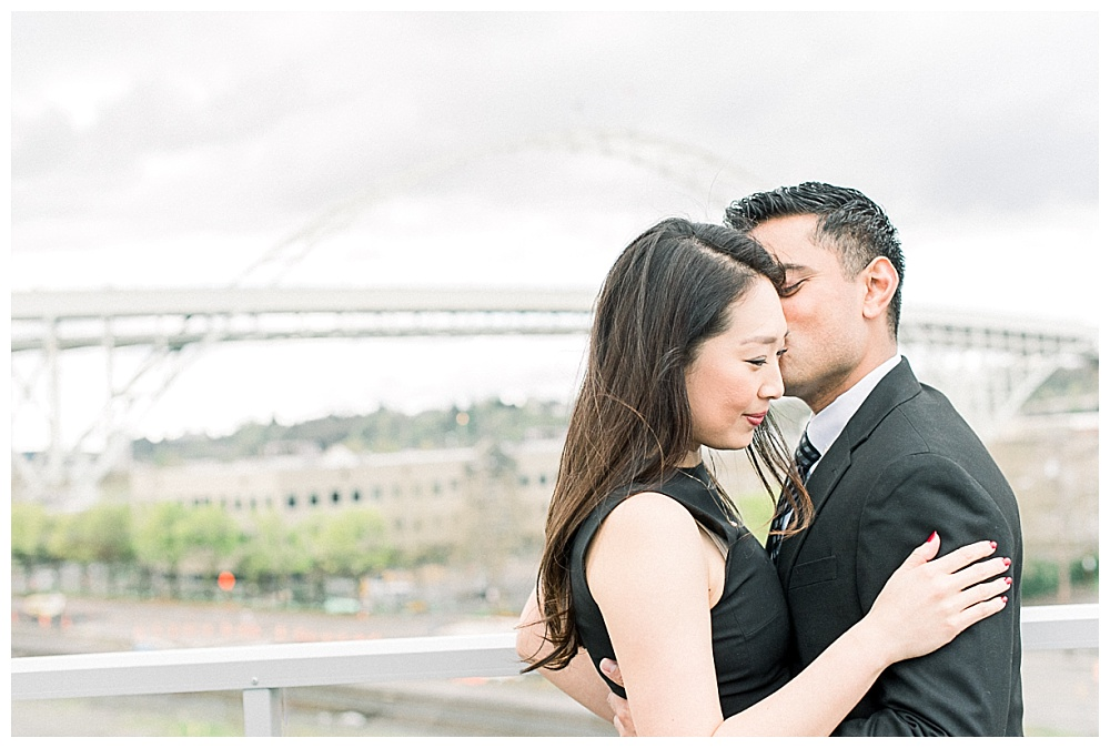 rooftop engagement session in front of the fremont bridge in portland, oregon