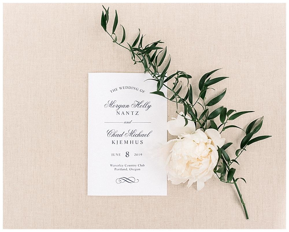 wedding invitation styled flat lay on blush background. Waverley Country Club